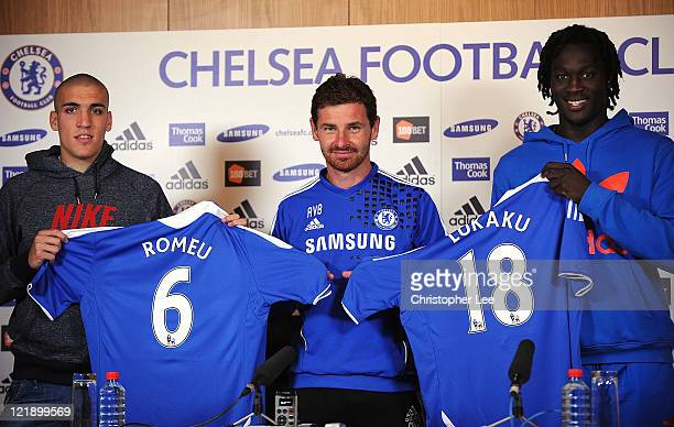 Oriel Romeu Manager Andre Villas Boas and Romelu Lukaku pose for the camera's during the Chelsea new signings of Oriol Romeu and Romelu Lukaku press...