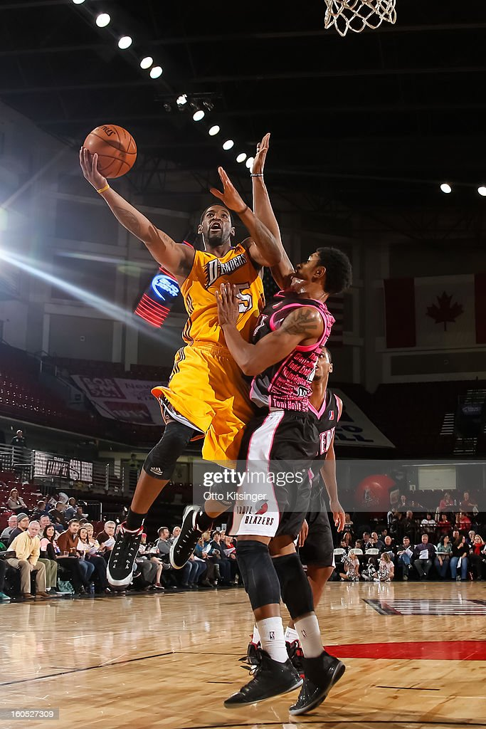 Orien Greene of the Los Angeles DFenders shoots over Justin Harper of the Idaho Stampede during the NBA DLeague game on February 1 2013 at...