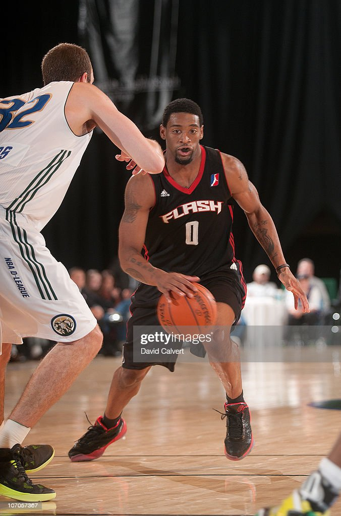 Orien Greene #0 of the Utah Flash dribbles toward <a gi-track='captionPersonalityLinkClicked' href=/galleries/search?phrase=Nick+Fazekas&family=editorial&specificpeople=805443 ng-click='$event.stopPropagation()'>Nick Fazekas</a> # 32 of the Reno Bighorns during the game on November 21, 2010 at the Reno Events Center in Reno, Nevada.
