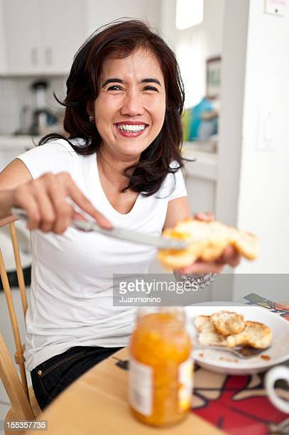 Oriental Housewife Having Breakfast
