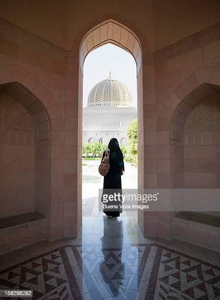 Oriental woman entering a Mosque