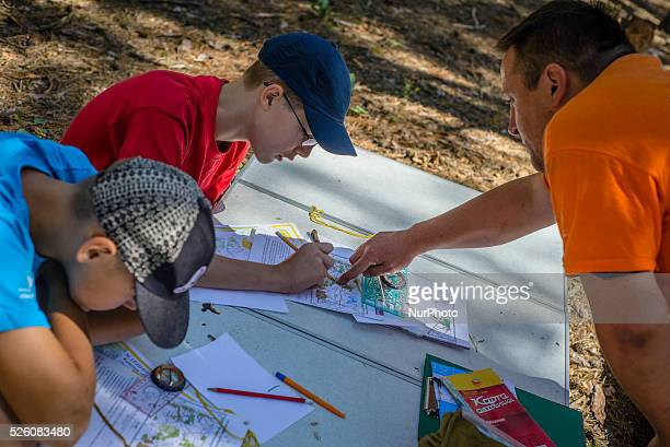 Orienteering education with map and compass for boy scouts in Ukrainian scout training camp Kiev region Ukraine
