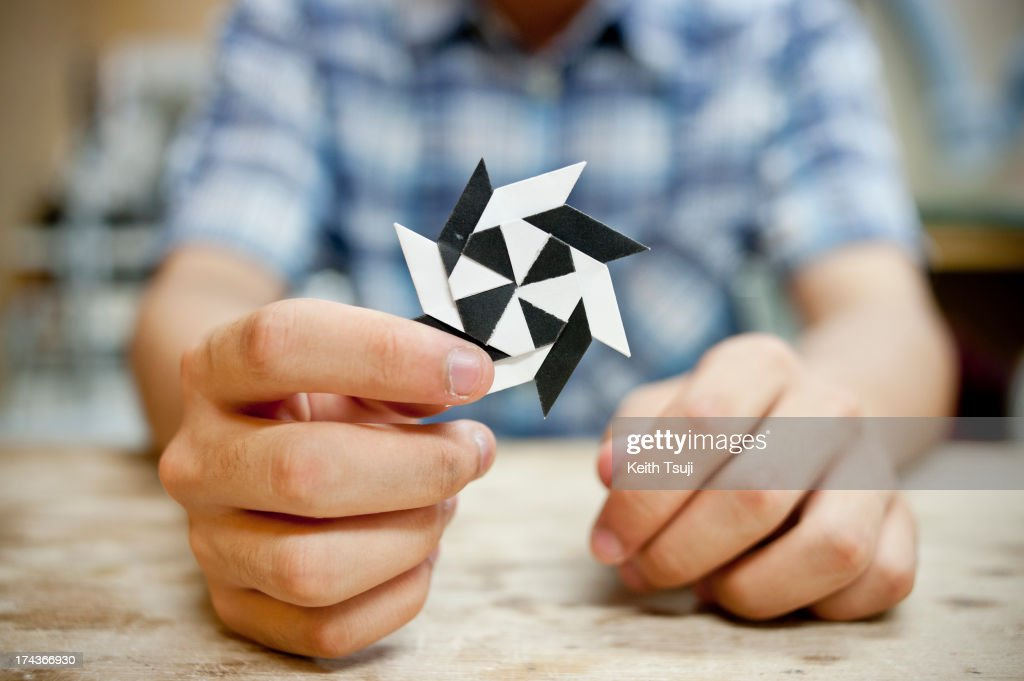 Origami artist Toma Takeda, displays one of his own creations, the origami Shuriken (Throwing star) on July 17, 2013 in Yokohama, Japan. Self-taught origami artist, Toma Takeda was diagnosed with Moyamoya disease and had surgery at the age of 8. During his 2 months recovery in the hospital he started to learn the art of origami to pass time and mastered the skill after many years of practice. Unless he finds it necessary, most of his origami works are created without using glue or scissors and can be folded with one piece of paper. Toma, now 16, continues origami as his main hobby and spends time at a local private art workshop owned by a fine artist to learn drawing with hopes to work in the arts or related fields in the future.