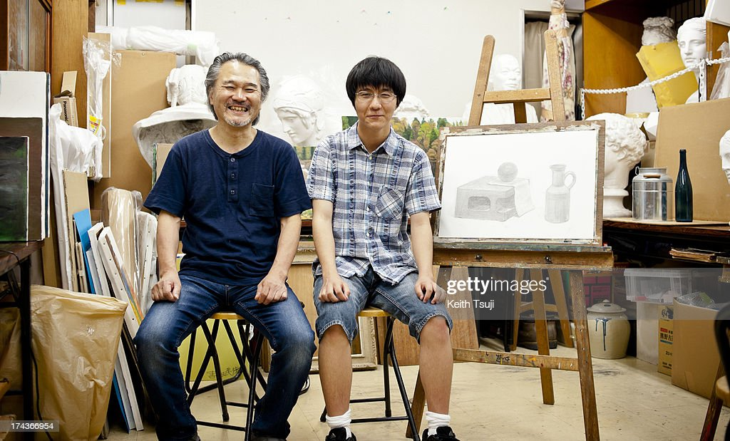 Origami artist, Toma Takeda poses for a photo with his drawing teacher Mr. Sakurai on July 17, 2013 in Yokohama, Japan. Self-taught origami artist, Toma Takeda was diagnosed with Moyamoya disease and had surgery at the age of 8. During his 2 months recovery in the hospital he started to learn the art of origami to pass time and mastered the skill after many years of practice. Unless he finds it necessary, most of his origami works are created without using glue or scissors and can be folded with one piece of paper. Toma, now 16, continues origami as his main hobby and spends time at a local private art workshop owned by a fine artist to learn drawing with hopes to work in the arts or related fields in the future.