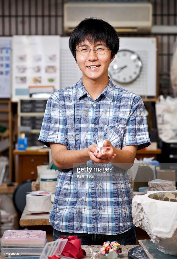 Origami artist Toma Takeda, poses for a portrait in the workshop on July 17, 2013 in Yokohama, Japan. Self-taught origami artist, Toma Takeda was diagnosed with Moyamoya disease and had surgery at the age of 8. During his 2 months recovery in the hospital he started to learn the art of origami to pass time and mastered the skill after many years of practice. Unless he finds it necessary, most of his origami works are created without using glue or scissors and can be folded with one piece of paper. Toma, now 16, continues origami as his main hobby and spends time at a local private art workshop owned by a fine artist to learn drawing with hopes to work in the arts or related fields in the future.