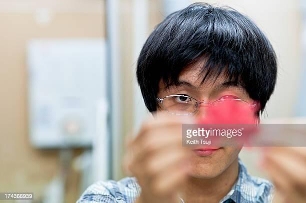 Origami artist Toma Takedashows his version of Kabuto on July 17 2013 in Yokohama Japan Selftaught origami artist Toma Takeda was diagnosed with...