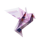 Origami Bird from banknotes on a white background