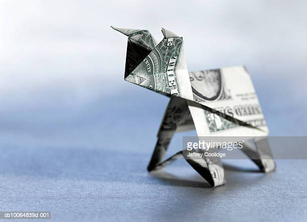 Origami bull made from dollar bill, close-up