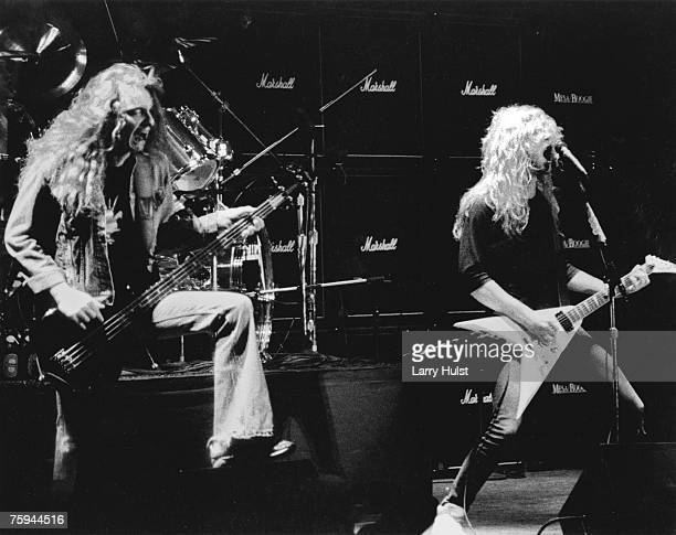 Original bassist Cliff Burton and singer and guitarist James Hetfield of the heavy metal quartet Metallica perform onstage in 1981