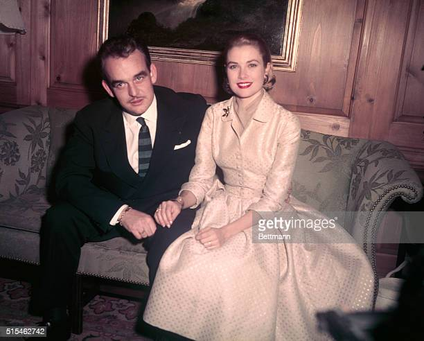 1/5/56Philadelphia PA Prince Rainier III of Monaco and lovely Grace Kelly reigning 'Queen' of the American screen pose for photographers at the home...