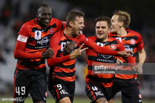Oriol Riera of the Wanderers celebrates with team mates after scoring a goal in extra time during the FFA Cup round of 32 match between the Western...