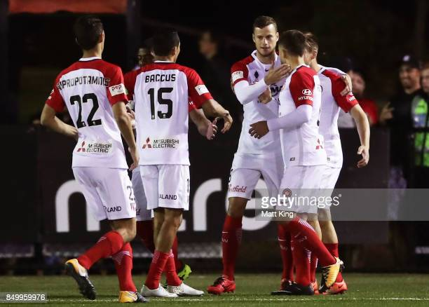 Oriol Riera of the Wanderers celebrates with team mates after scoring a goal during the FFA Cup Quarterfinal match between Blacktown City and the...