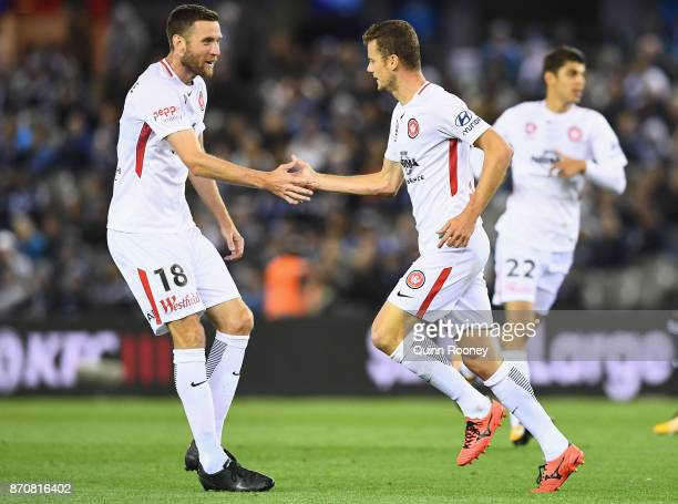Oriol Riera of the Wanderers is congratulated by Robert Cornthwaite after kicking a goal scoring a goal during the round five ALeague match between...