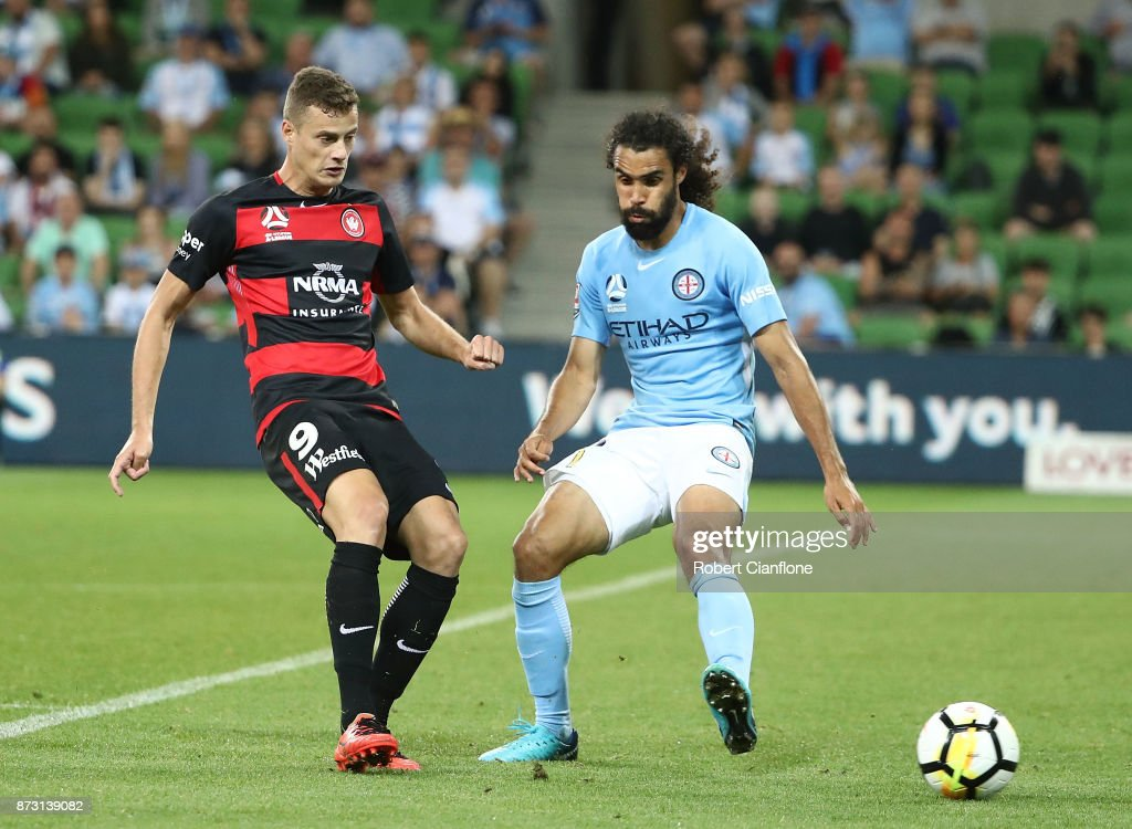 Oriol Riera of the Wanderers is pressured by Osama Malik of the City during the round six A-League match between Melbourne City and the Western Sydney Wanderers at AAMI Park on November 12, 2017 in Melbourne, Australia.