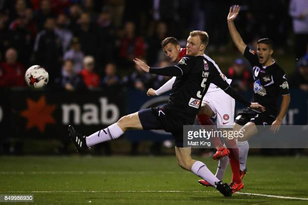 Oriol Riera of the Wanderers takes a shot on goal as Grant Lynch of Blacktown City defends during the FFA Cup Quarterfinal match between Blacktown...