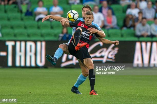 Oriol Riera of the Western Sydney Wanderers and Bart Schenkeveld of Melbourne City contest the ball during Round 6 of the Hyundai ALeague Series...