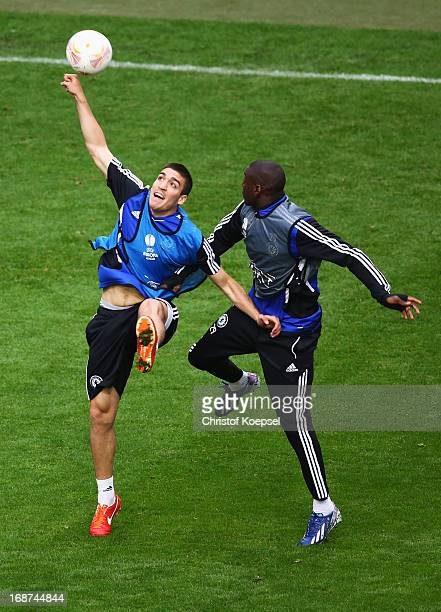 Oriol Romeu of Chelsea and Demba Ba of Chelsea compete for the ball during a Chelsea training session ahead of the UEFA Europa League Final match...