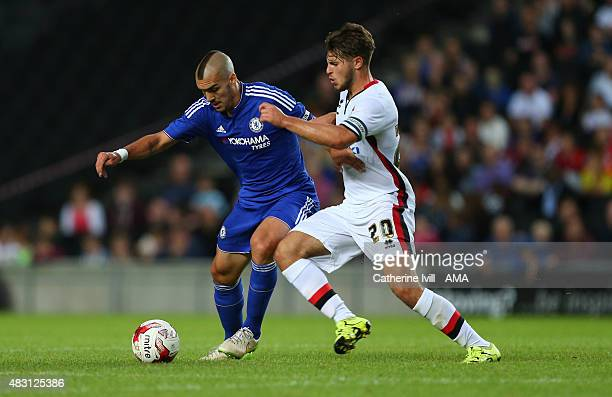 Oriol Romeu of Chelsea and Giorgio Rasulo of MK Dons in action during the preseason friendly between MK Dons and a Chelsea XI at Stadium mk on August...