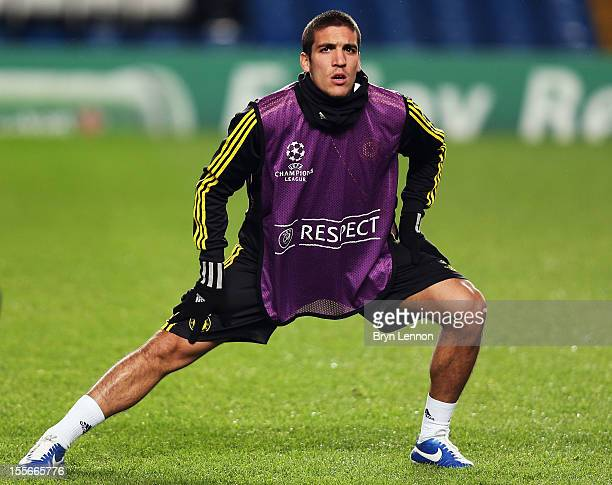 Oriol Romeu of Chelsea stretches during a Chelsea Training Session and Press Conference ahead of tomorrow's UEFA Champion's League match between...