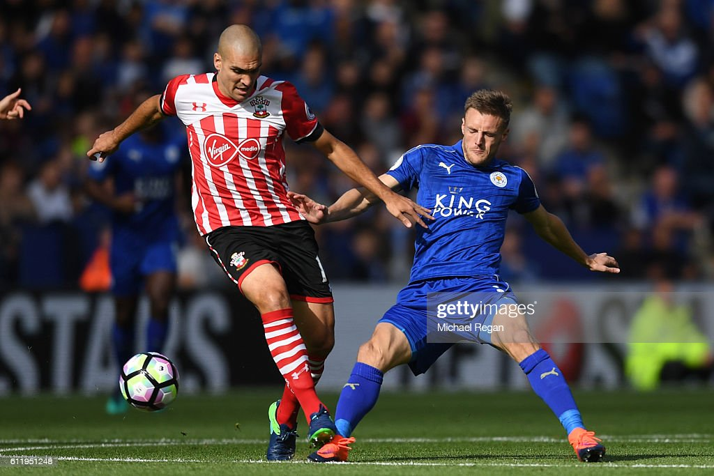 Oriol Romeu of Southampton (L) and Jamie Vardy of Leicester City (R) battle for possession during the Premier League match between Leicester City and Southampton at The King Power Stadium on October 2, 2016 in Leicester, England.