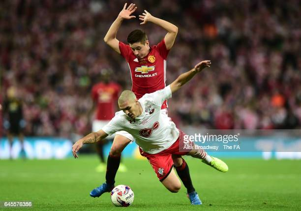 Oriol Romeu of Southampton battles with Ander Herrera of Manchester United during the EFL Cup Final between Manchester United and Southampton at...