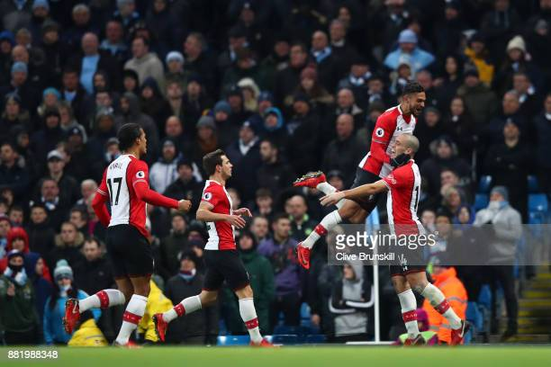 Oriol Romeu of Southampton celebrates after scoring his sides first goal with Sofiane Boufal of Southampton during the Premier League match between...