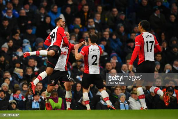 Oriol Romeu of Southampton celebrates after scoring his sides first goal with Sofiane Boufal of Southampton and Cedric Soares of Southampton during...