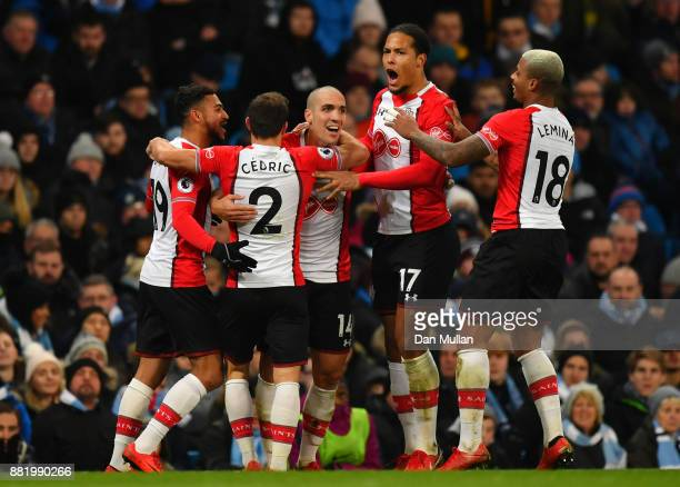 Oriol Romeu of Southampton celebrates after scoring his sides first goal with his Southampton team mates during the Premier League match between...