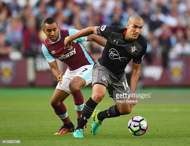 Oriol Romeu of Southampton evades Dimitri Payet of West Ham United during the Premier League match between West Ham United and Southampton at London...