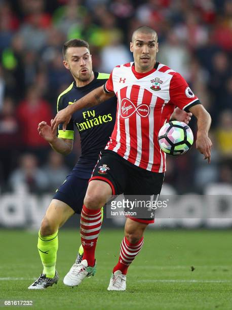 Oriol Romeu of Southampton is closed down by Aaron Ramsey of Arsenal during the Premier League match between Southampton and Arsenal at St Mary's...
