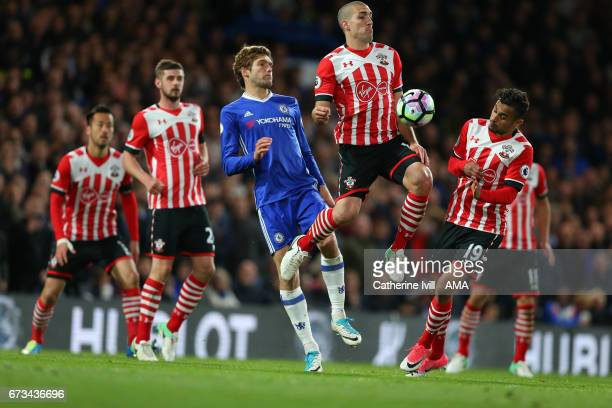 Oriol Romeu of Southampton is watched by his team mates and Marcos Alonso of Chelsea during the Premier League match between Chelsea and Southampton...