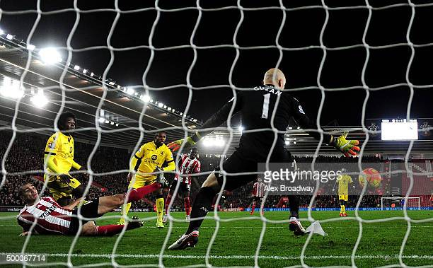 Oriol Romeu of Southampton scores his team's first goal past Brad Guzan of Aston Villa during the Barclays Premier League match between Southampton...
