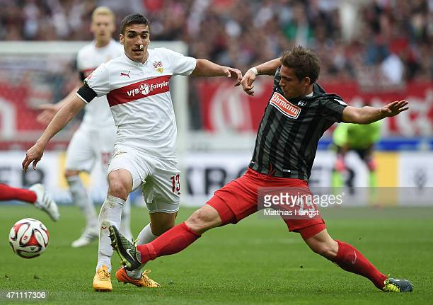 Oriol Romeu Vidal of Stuttgart is challenged by Oliver Sorg of Freiburg during the Bundesliga match between VfB Stuttgart and SC Freiburg at...