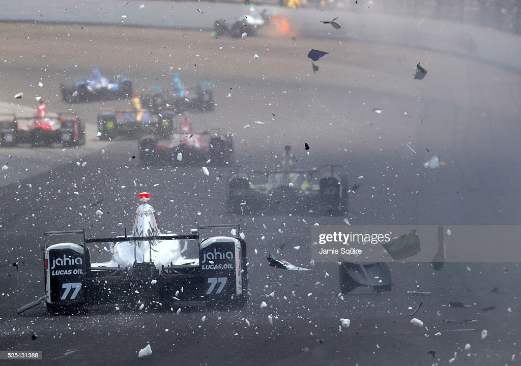 Oriol Servia, driver of the #77 Schmidt Peterson with Marioti Racing Honda Dallara, drives through a field of debris left by the crash of Sage Karam, driver of the # 24 DRR-Kingdom Racing Chevrolet Dallara, during the 100th running of the Indianapolis 500 at Indianapolis Motorspeedway on May 29, 2016 in Indianapolis, Indiana.