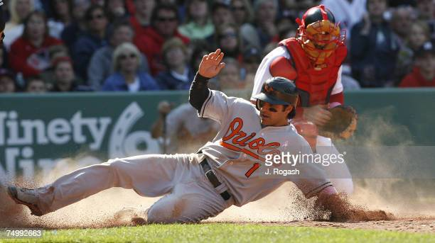 Orioles' Brian Roberts scores by Red Sox catcher Jason Varitek during a game between the Boston Red Sox and the Baltimore Orioles Sunday May 13 2007...