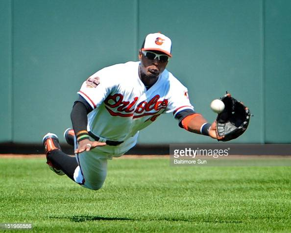 Orioles center fielder Adam Jones makes a diving catch on a sacrifice fly ball by the Rays' Jeff Keppinger in the 4th inning The Baltimore Orioles...