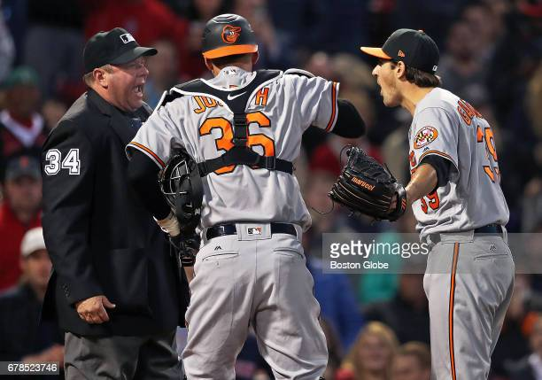 Orioles starting pitcher Kevin Gausman right and catcher Caleb Joseph center argue with home plate umpire Sam Holbrook left who had just ejected...