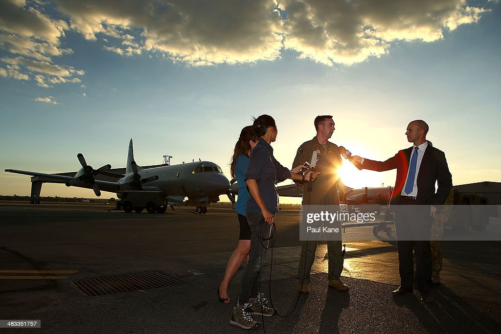 Orion captain Flt Lt Benn Carroll speaks to reporters after returning from a search mission for debris from missing Malaysia Airlines flight MH370 at...