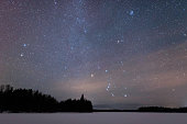 Orion constellation above frozen lake