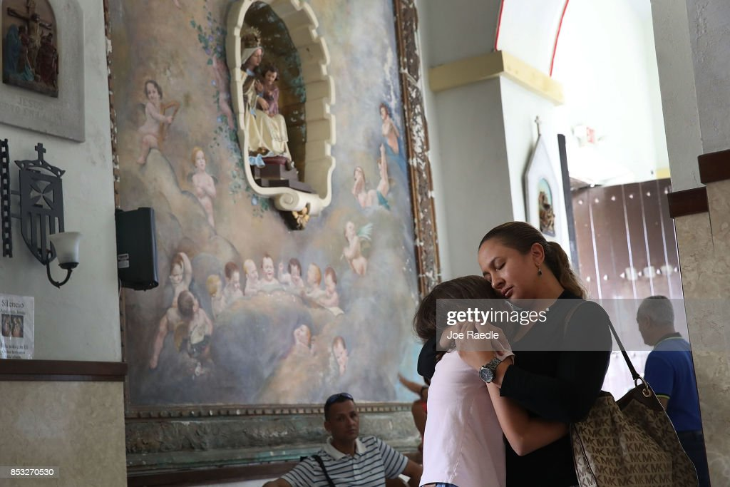 Orisnela Solano hugs her daughter, Laura Goenaga as they attend a church service at the Parroquia Nuestra Senora de la Asuncion church September 24, 2017 in Aibonito, Puerto Rico. Puerto Rico experienced widespread damage after Hurricane Maria, a category 4 hurricane, passed through.