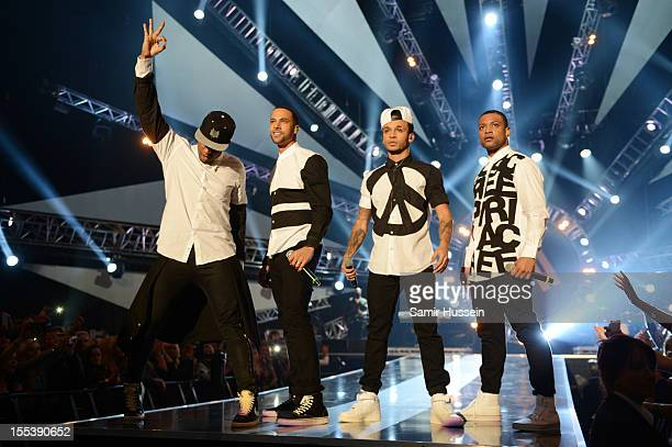 Oritse William Marvin Humes Aston Merrygold Aston Merrygold and Jonathan 'JB' Gill of JLS perfom onstage at the 2012 MOBO awards at Echo Arena on...
