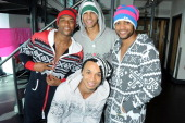 Oritse Williams Marvin Humes Aston Merrygold and Jonathan 'JB' Gill of JLS pose as they prepare to embark on their upcoming 'The 4th Dimension 2012'...