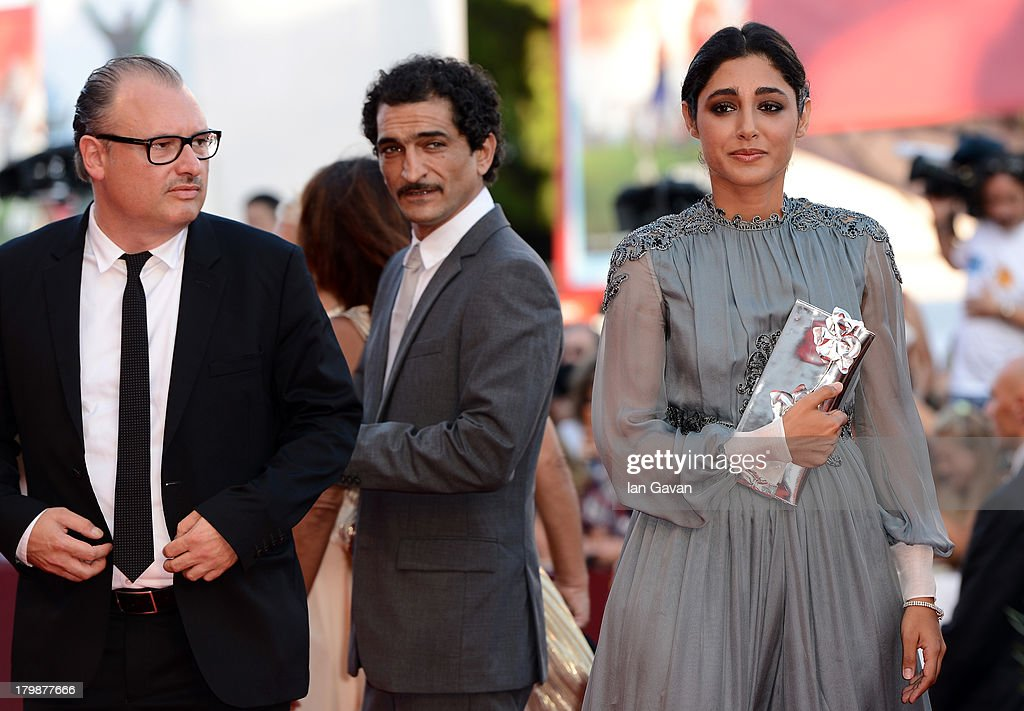 Orizzonti Jury members Frederic Fonteyne, Amr Waked and Iranian actress <a gi-track='captionPersonalityLinkClicked' href=/galleries/search?phrase=Golshifteh+Farahani&family=editorial&specificpeople=5535488 ng-click='$event.stopPropagation()'>Golshifteh Farahani</a> wears a Jaeger-LeCoultre Vintage Couvercle watch on the red carpet during the Closing Ceremony of the 70th Venice International Film Festival at Palazzo del Cinema on September 7, 2013 in Venice, Italy.