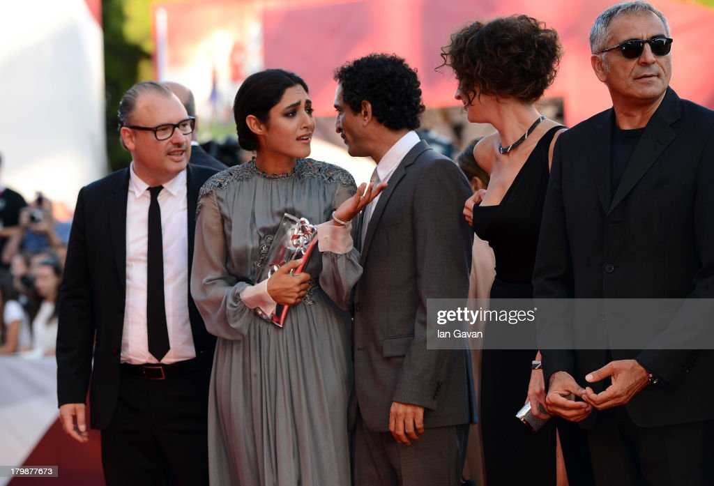 Orizzonti Jury members Frederic Fonteyne, Iranian actress <a gi-track='captionPersonalityLinkClicked' href=/galleries/search?phrase=Golshifteh+Farahani&family=editorial&specificpeople=5535488 ng-click='$event.stopPropagation()'>Golshifteh Farahani</a> wears a Jaeger-LeCoultre Vintage Couvercle watch, Amr Waked, <a gi-track='captionPersonalityLinkClicked' href=/galleries/search?phrase=Ksenia+Rappoport&family=editorial&specificpeople=4333988 ng-click='$event.stopPropagation()'>Ksenia Rappoport</a> and Leonardo Di Costanzo on the red carpet during the Closing Ceremony of the 70th Venice International Film Festival at Palazzo del Cinema on September 7, 2013 in Venice, Italy.