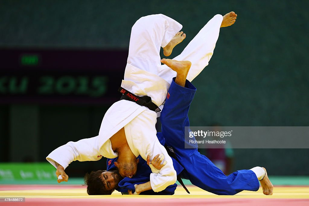 <a gi-track='captionPersonalityLinkClicked' href=/galleries/search?phrase=Orkhan+Safarov&family=editorial&specificpeople=11293782 ng-click='$event.stopPropagation()'>Orkhan Safarov</a> (white) of Azerbaijan and Beslan Mudranov (blue) of Russia compete in the Men's -60kg gold medal bout on day thirteen of the Baku 2015 European Games at the Heydar Aliyev Arena on June 25, 2015 in Baku, Azerbaijan.