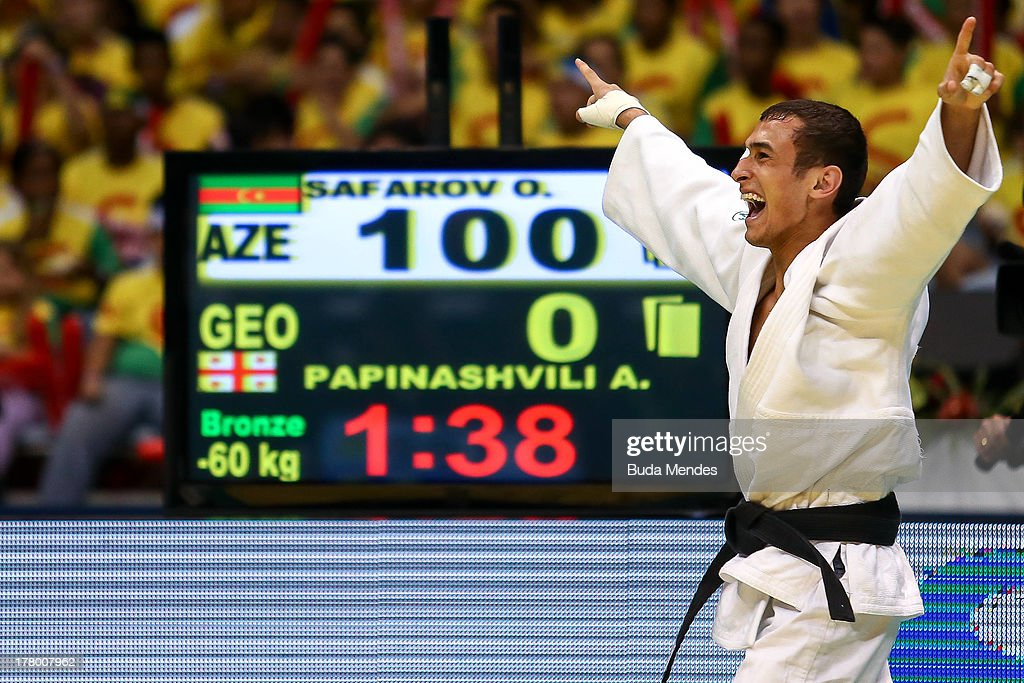 Orkhan Safarov (white) of Azerbaijan celebrates a victory against Amiran Papinashvili of Georgia in the -60 kg category during the World Judo Championships at the Maracanazinho gymnasium on August 26, 2013 in Rio de Janeiro, Brazil.