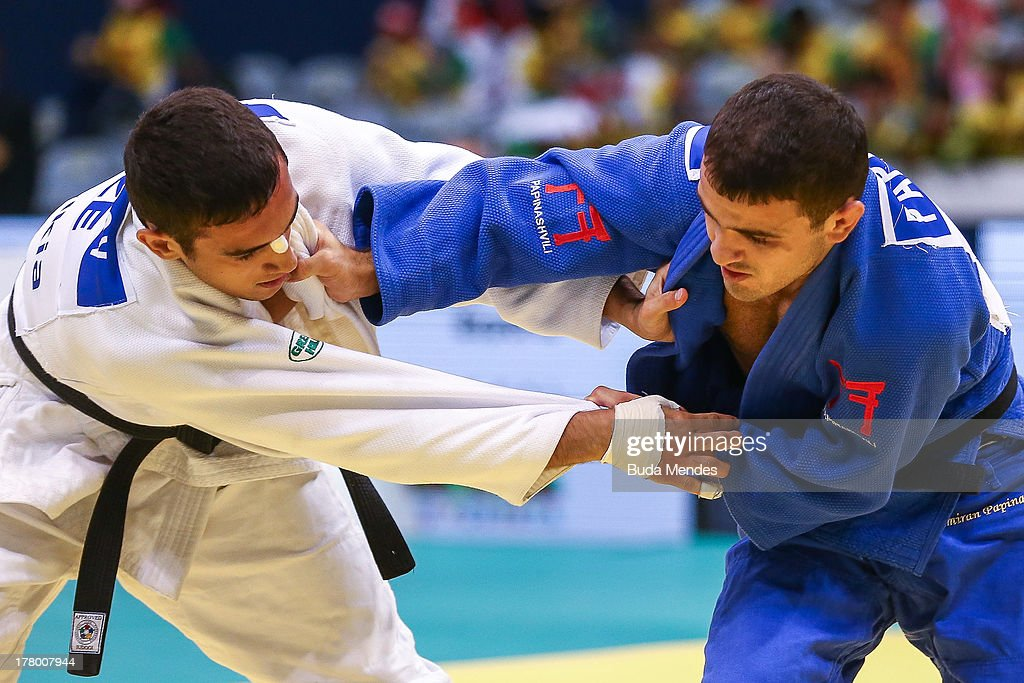 Orkhan Safarov (white) of Azerbaijan fights against Amiran Papinashvili of Georgia in the -60 kg category during the World Judo Championships at the Maracanazinho gymnasium on August 26, 2013 in Rio de Janeiro, Brazil.