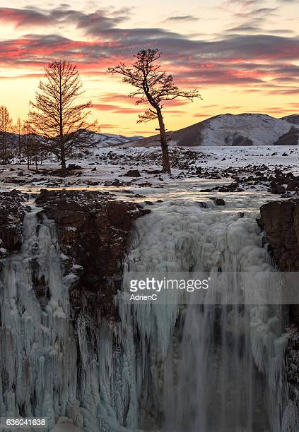 Orkhon waterfall, a frozen waterfall during sunset located in the middle of Mongolia