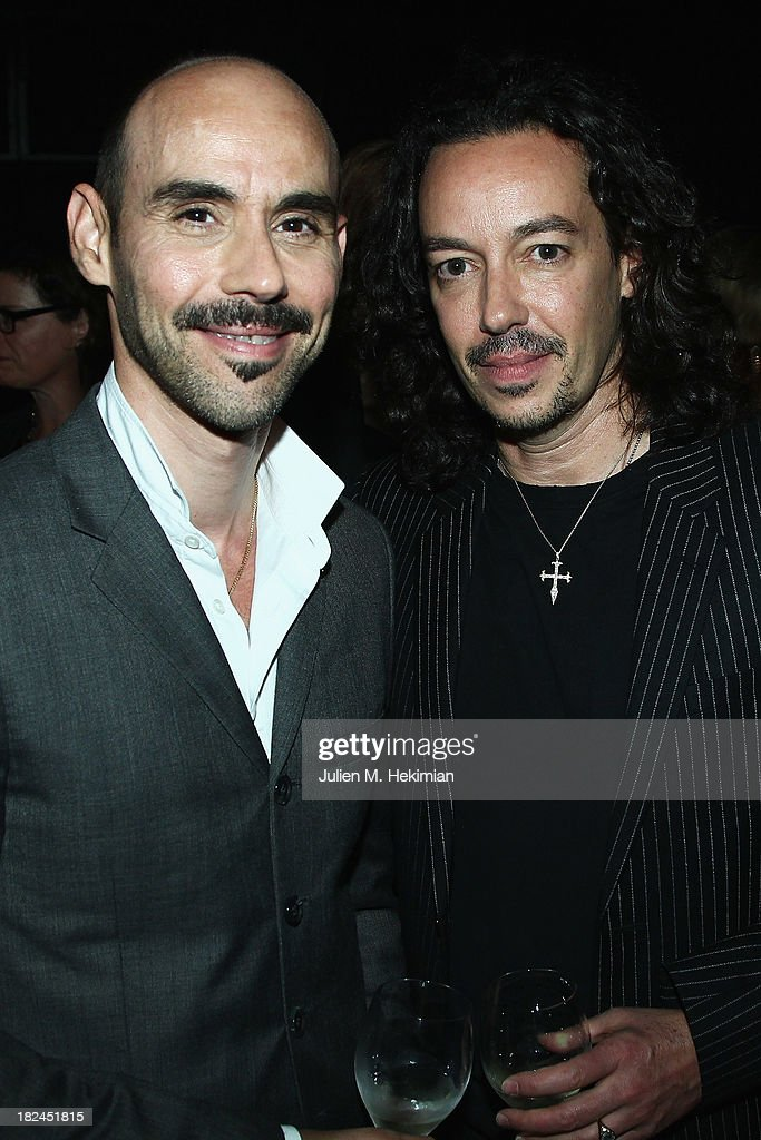 Orland Pita (R) and his brother Rafael Pita attend the Glamour dinner for Patrick Demarchelier as part of the Paris Fashion Week Womenswear Spring/Summer 2014 at Monsieur Bleu restaurant on September 29, 2013 in Paris, France.