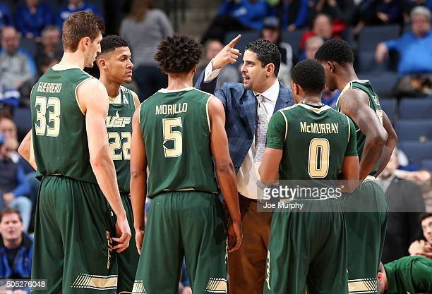 Orlando Antigua head coach of the USF Bulls instructs his players during a timeout against the Memphis Tigers on January 16 2016 at FedExForum in...